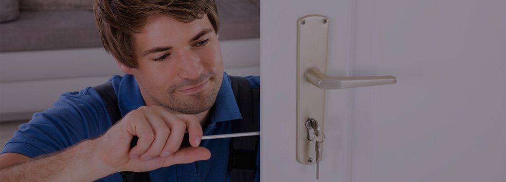 Man working on internal door lock